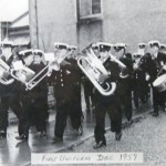 Brass band modelling their first uniforms, 1959
